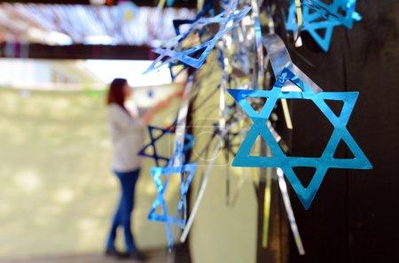 Jewish woman decorating here family Sukkah