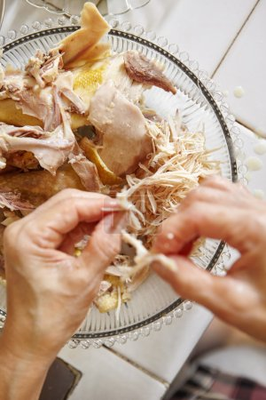Photo for Shredded chicken for the ingredient for Soto, the traditional Indonesian chicken soup - Royalty Free Image