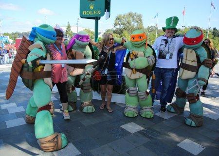 Australian tennis fans taken pictures with Teenage Mutant Ninja Turtles during Australian Open 2016