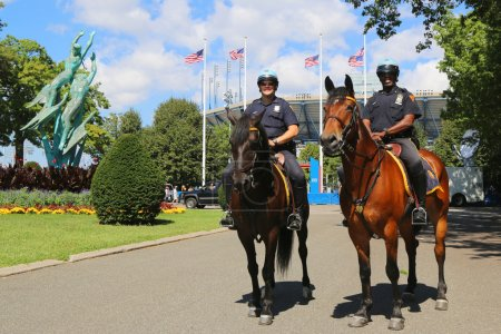 NYPD police officers on horseback ready to protect public at Billie Jean King National Tennis Center during US Open 2014