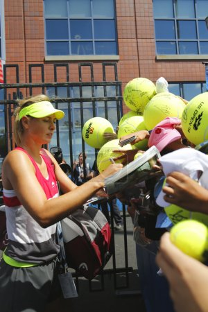 Five times Grand Slam champion Maria Sharapova signing autographs after practice for US Open 2014