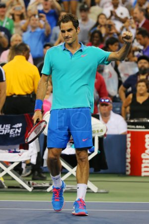 Grand Slam champion Roger Federer celebrates victory after third round match at US Open 2014 against Marcel Granollers