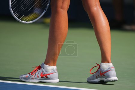 Five times Grand Slam champion Mariya Sharapova wears custom Nike tennis shoes during match at US Open 2014