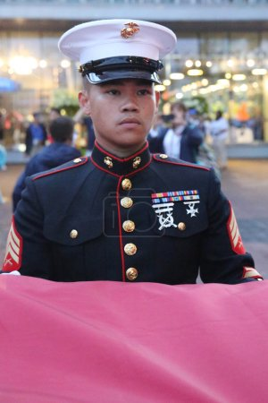 United States Marine Corps officer at Billie Jean King National Tennis Center before unfurling the American flag prior US Open 2015 men's final
