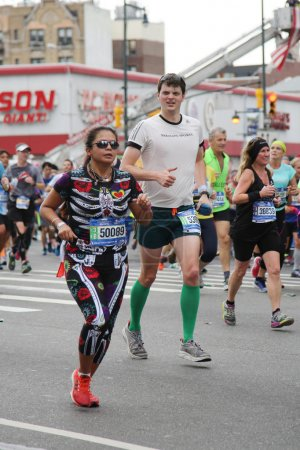 New York City Marathon runners traverse 26.2 miles through all five NYC borough