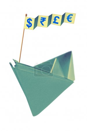 Origami paper boat with flag writing different currency signs