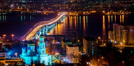 beautiful landscape of evening city Saratov with church and brid
