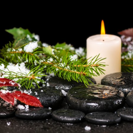 winter spa still life of zen basalt stones, evergreen branches,
