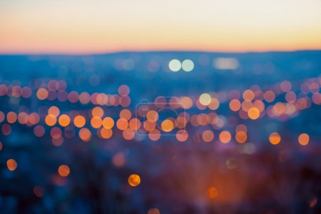 Big city lights in the twilight evening with blurring background