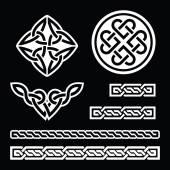 Irish Celtic white heart pattern isolated on black background