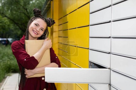 The girl is very tight and happy because the package she has been waiting for has finally reached her.