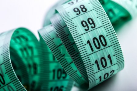 urved measuring tape. Measuring tape of the tailor. Closeup view of Green measuring tape