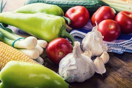 Fresh vegetables. Overhead view of a assortment of farm fresh vegetables, Green pepper, garlic, corn, onions, tomatoes, cucumbers