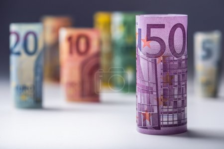 Several hundred euro banknotes stacked by value. Euro money concept. Rolls Euro  banknotes. Euro currency. Announced cancellation of five hundred euro banknotes. Banknotes stacked on each other in different positions. Toned photo