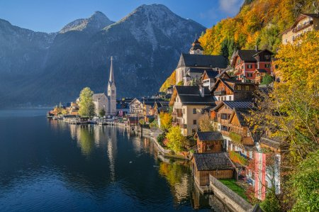 Photo for Scenic picture-postcard view of famous Hallstatt mountain village with Hallstatter See in the Austrian Alps in beautiful golden morning light in fall, region of Salzkammergut, Austria - Royalty Free Image