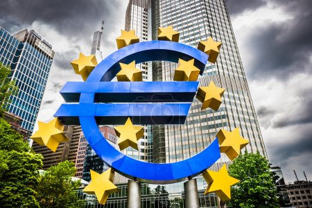 Euro sign with dark clouds at European Central Bank headquarters in Frankfurt, Germany