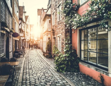 Old town in Europe at sunset with retro vintage filter effect