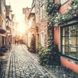 Old town in Europe at sunset with retro vintage In...