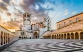 Famous Basilica of St. Francis of Assisi at sunset in Assisi, Umbria, Italy