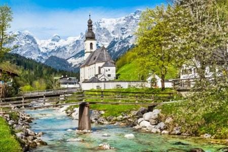 Scenic mountain landscape in the Alps with small church in springtime