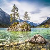 Idyllic landscape with trees on a rock at lake Hintersee, Nationalpark Berchtesgadener Land, Bavaria, Germany