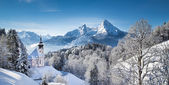 Scenic winter landscape in the Alps with small pilgrimage church
