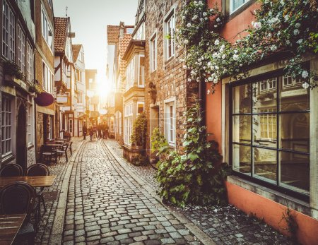 Photo for Old town in Europe at sunset with retro vintage Instagram style filter and lens flare effect. - Royalty Free Image