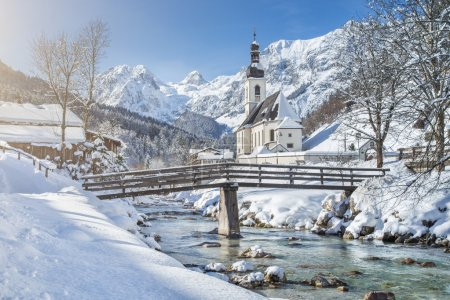 Scenic winter landscape in the Alps with pilgrimage church