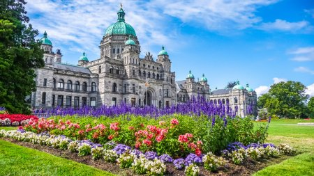 Historic parliament building in Victoria with colorful flowers, BC, Canada
