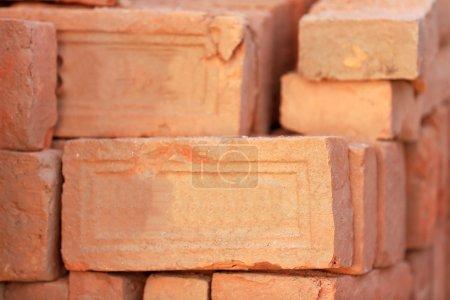 Building materials: red bricks for construction pi...