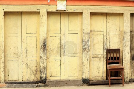 Wooden chair embedded in wooden wall of a newar st...