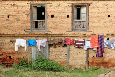 Laundry wash hanging to get dried on a clothes rac...