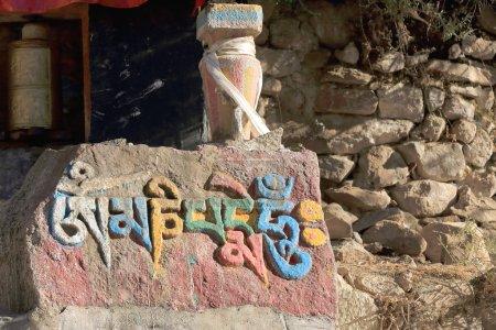 Buddhist mani stone-om mani padme hum. Drepung monastery-Tibet-China. 1198