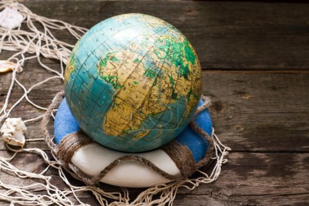 Globe on the lifebuoy earth day and save the world concept