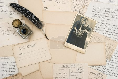 Letters, postcards and eather pen.