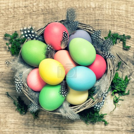 Easter eggs with feather decoration vintage toned