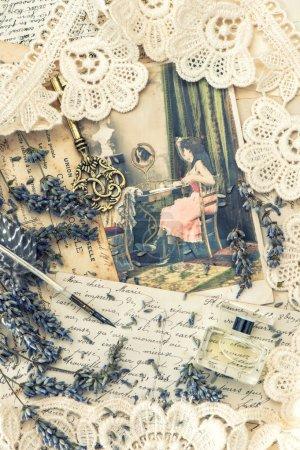 vintage ink pen, key, perfume, lavender flowers and old love let