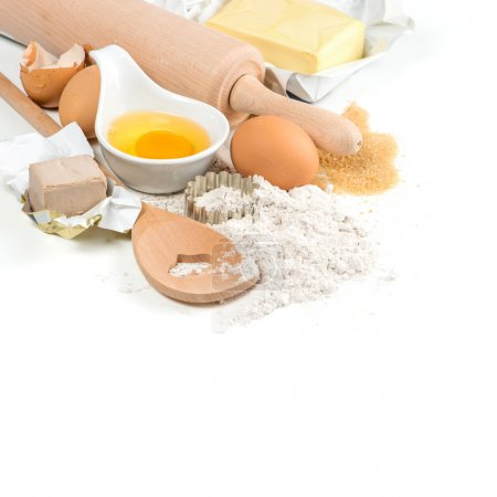 Photo for Baking ingredients eggs, flour, yeast, sugar, butter. kitchen utensils. food background - Royalty Free Image