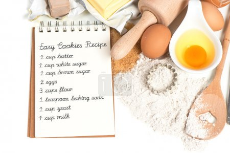 Photo for Recipe book and baking ingredients eggs, flour, sugar, butter, yeast. food background. Sample text Easy Cookies Recipe - Royalty Free Image