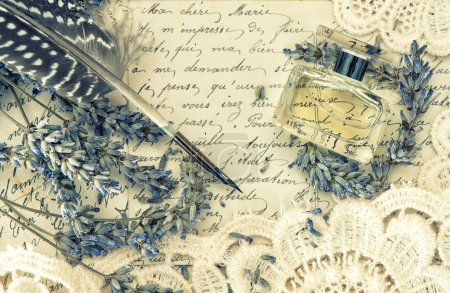 Antique ink pen, perfume, old love letters and lavender flowers