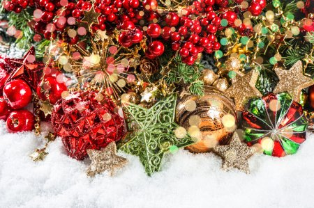 Photo for Christmas tree branches with baubles, golden garlands and lights. holidays background with colorful defocused lights - Royalty Free Image