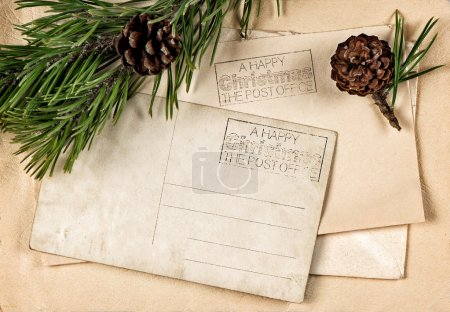 Vintage christmas postcard with pine tree branch