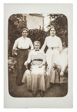 Original antique photo. Three women wearing vintage clothing
