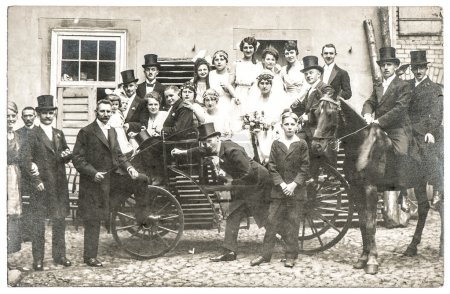 Antique wedding photo with people in vintage clothing