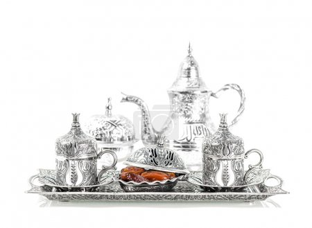 Table setting with silver tableware and dates. Oriental hospital