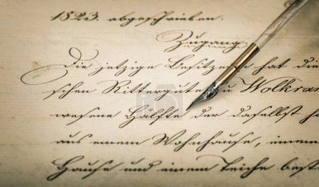 Calligraphic handwritten text and vintage ink pen