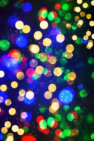 Defocused lights christmas decorations. Abstract shiny backgroun