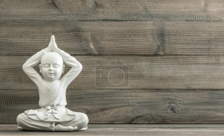Sitting buddha. White monk statue. Meditation. Relaxing