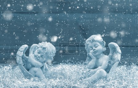 Slipping guardian angel. Christmas decoration. Vintage style blu
