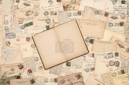 Old handwritten postcards open book